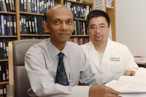 Drs. Chandra Mohan (left) and Tianfu Wu are members of a research team which discovered that a compound related to a drug used to prevent human organ-transplant rejection also attacks a key biochemical process in the faulty immune cells of lupus-prone mice.