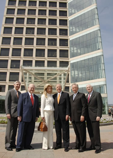 From left, Dr. Kern Wildenthal, president of<br>UT Southwestern, Mark Yudof, Chancellor of the UT System, Madeleine Pickens, T. Boone Pickens, James Huffines, Chairman of the Board of Regents of the UT System, and Dr. Eugene Frenkel, professor of internal medicine at UT Southwestern, gather after the announcement of a $50 million donation by the T. Boone Pickens Foundation to ensure the continued excellence and prominence of UT Southwestern into the future. In recognition of the landmark gift, the 800,000-square-foot, 14-story medical research and education facility the group stands in front of on UT Southwestern's North Campus will be named the T. Boone Pickens Biomedical Building. Completed in 2005, it is the largest research building ever built for a Texas university.