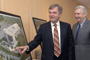 Dr. Dennis Stone (left), vice president for technology development, and Dr. Kern Wildenthal, president of Southwestern Medical Foundation, admire architectural renderings of the new BioCenter at Southwestern Medical District.