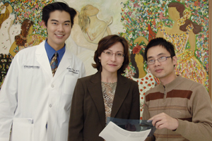 Dr. Christine Garcia (center) led researchers, including Dr. Philip Kuan (left) and Dr. Yongyu Wang, in discovering that a mutation in a gene known for its role in defending the lungs against invading pathogens is responsible for some inherited cases of a lethal lung disease affecting older adults.