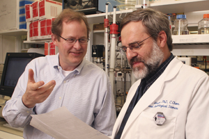 Drs. Philip Thorpe (left) , professor of pharmacology, and Ralph Mason, professor of radiology, have shown in animals that arsenic linked to a drug that binds to the blood vessels of cancerous tumors provides a powerful imaging agent.