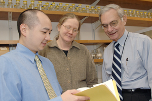 Dr. John Dietschy (right), along with colleagues Drs. Benny Liu and Joyce Repa, has identified a compound that liberates cholesterol that has inappropriately accumulated to excessive levels inside cells. This cholesterol accumulation is a characteristic of Niemann-Pick type C disease.