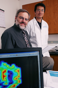 Drs. Ralph Mason (left) and Dawen Zhao, both radiologists, have demonstrated that blood oxygen level dependent MRIs might help oncologists determine the best treatment for some cancer patients.