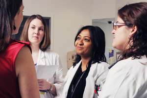Dr. Vineeta Mittal (center) has found that family-centered rounds help medical students such as Allison Bonds (left, facing camera) and Megan Skinner (right).