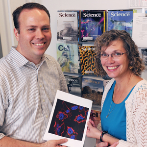 Dr. Kim Orth (right) and graduate student Chris Broberg discovered the mechanism by which a bacterium found in shellfish causes food poisoning.