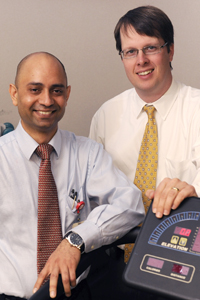 Drs. Jarett Berry (right) and Sachin Gupta found that middle-aged men's risk of heart disease is closely tied to their fitness level.
