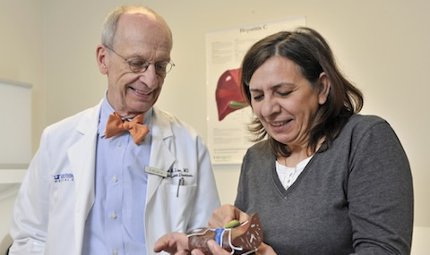 Dr. William Lee uses a model of a liver to explain to patient Patrizia Cazzaniga the damage that hepatitis C can do without treatment. Mrs. Cazzaniga is now virus-free after taking part in a clinical trial at UT Southwestern testing new hepatitis C drugs.
