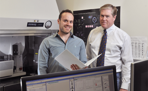 Dr. Sean Morrison, Director of the Children's Research Institute, right; Dr. Robert A.J. Signer, a postdoctoral research fellow