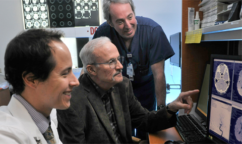 Drs. Magadan and White (l-r) review images with Tom Guynes (center)