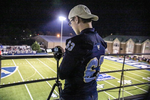 Hunter filming night game