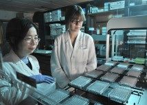 Screening scientists Shuguang Wei, Ph.D., and Stephanie Perkins oversee the BioMekFX during a screening experiment.