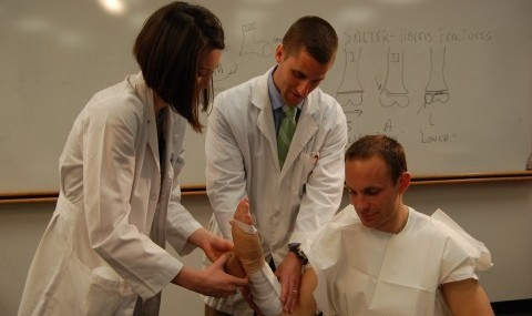 Physician Assistant students learn casting techniques for fractures.