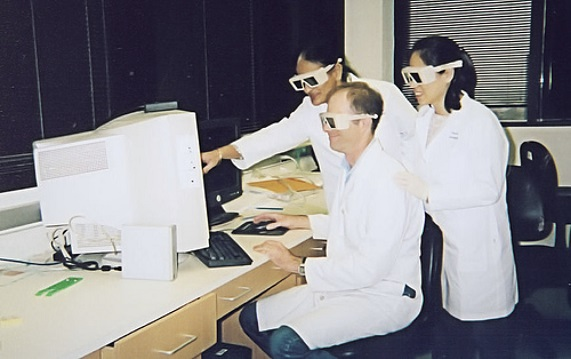 Lab members wearing goofy glasses
