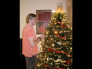 Andrew by the Christmas tree