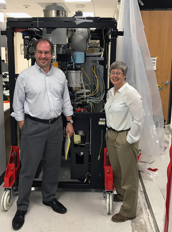 Faculty members posing with machine