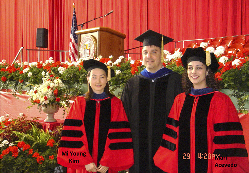 A photo of Dr. Kraus with his first graduates, Mi Young Kim and Mari Acevedo, 2004