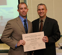 Dr. Steven Vernino presents award to Dr. James Battiste