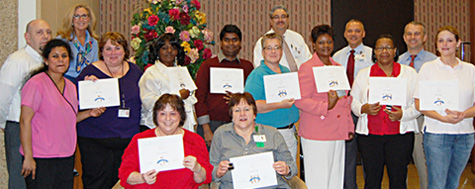 Group of employees honored for their years of service to the Neurology department