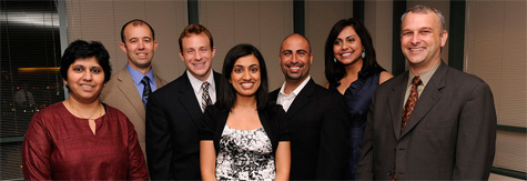 Dr. Shilpa Chitnis and Dr. Steven Vernino stand with group of graduates