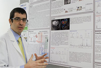 Isaac Marin-Valencia with his brain tumor research poster