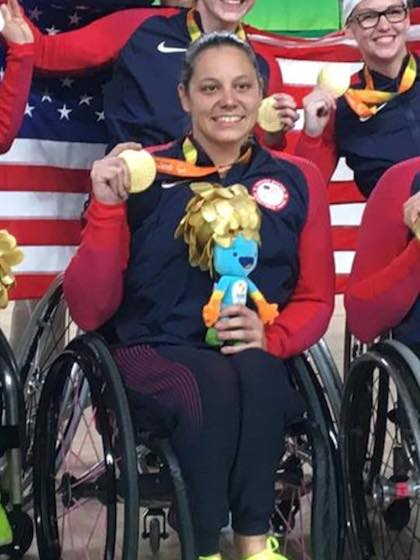 Darlene Hunter holds the gold medal she earned in wheelchair basketball at the 2016 Summer Paralympics in Rio de Janeiro. Ms. Hunter is now helping UT Southwestern raise awareness about the benefits of adaptive sports for people with mobility, cognitive, or visual impairments.