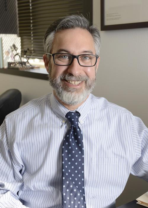 Dr. Adam Brenner