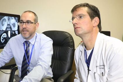 "Dr. Ivan Pedrosa, left, and Dr. Jeffrey Cadeddu, right, are co-authors of a study highlighted on the cover of The Journal of Urology on multiparametric MRI (mpMRI) protocols that tell physicians with high confidence whether the tumor is aggressive."" width="